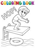 Malbuchjunge, der in Wasser springt Stockfotografie