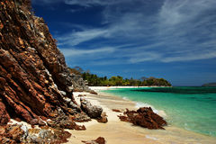 Malcapuya Coastalscapes. The sky, the rocks, the sand, and the water make malcapuya's shoreline such a wonder to behold Stock Photo