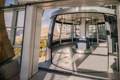 Malcesine, Italy - January 18, 2016: Cabin of the cableway Malcesine - Mount Baldo stop at the top station. Cabin of a cableway stop at mountain station royalty free stock images