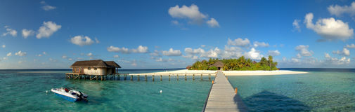 Maldive island resort. With a restaurant in the lagoon stock photos
