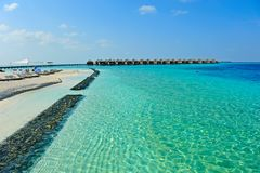 Maldive water villa and blue sea Royalty Free Stock Photo