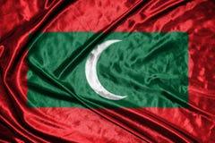 Maldiverna flagga flagga på bakgrund Royaltyfria Foton