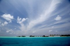 Maldives. When you travel by boat on the Maldives, you can see these paradise resorts Royalty Free Stock Photos