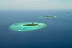 Maldives aerial panorama blue water reef Stock Images