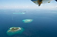 Maldives aerial panorama blue water reef Royalty Free Stock Photography