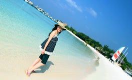 Maldives beach. Beautiful view of Maldives full moon island beach. Chinese girl's smile Royalty Free Stock Image