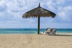 Maldives beach chairs. Beach chairs on the white sand beach. It could be any place of Maldives, Indian ocean, Pacific ocean, Bahamas,  Hawaii or caribbean sea Royalty Free Stock Photo