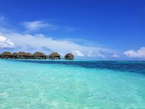 Maldives Beach Kani Club Med. Simply blue and irrestible royalty free stock photos
