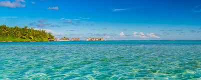 Maldives beach panorama under the blue sky Stock Image