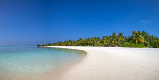Maldives beach panorama view with white sand and blue sky Royalty Free Stock Photos