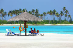 Maldives beach sunbathe Stock Photography