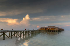Maldives beach villas in sunset scenery Royalty Free Stock Images