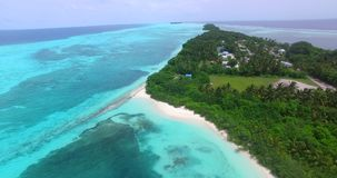 Maldives beautiful beach background white sandy tropical paradise island with blue sky sea water ocean 4k aerial. Drone flying flyover birds eye stock footage