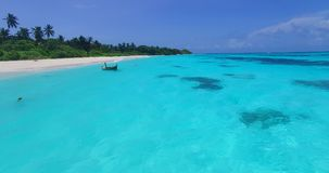 Maldives beautiful beach background white sandy tropical paradise island with blue sky sea water ocean 4k aerial stock video footage