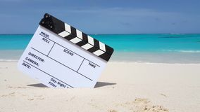 Maldives beautiful beach background white sandy tropical paradise island with blue sky sea water ocean 4k. Clapperboard film slate action cut stock footage