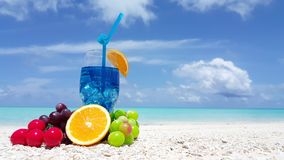 Maldives beautiful beach background white sandy tropical paradise island with blue sky sea water ocean 4k fruit. Cocktail blue drink stock video