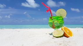 Maldives beautiful beach background white sandy tropical paradise island with blue sky sea water ocean 4k fruit. Cocktail ice drink stock footage