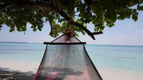 Maldives beautiful beach background white sandy tropical paradise island with blue sky sea water ocean 4k swing stock footage