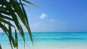 Maldives beautiful white sandy beach background with palm trees on sunny tropical paradise island with aqua blue Stock Images