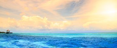 Maldives bungalows sunset panorama Stock Images