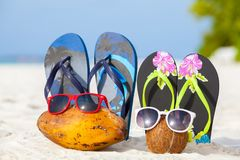 Maldives, coconuts with sunglasses and bathing shoes. On the beach Royalty Free Stock Photos