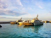 Maldives cost guard boats. Sea, blue, sky, clouds stock photos