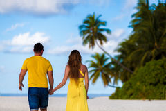 Maldives, a couple walking along the beach hand in hand Stock Photography