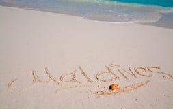 Maldives escritos en la arena fotografía de archivo
