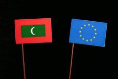 Maldives flag with European Union EU flag isolated on black. Background Royalty Free Stock Image