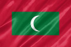 Maldives Flag. With waving on satin texture royalty free stock photo