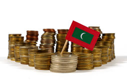 Maldives flag with stack of money coins Royalty Free Stock Images