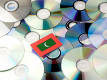 Maldives flag on top of CD and DVD pile isolated on white. Maldives flag on top of CD and DVD pile isolated Stock Images