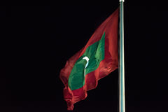 Maldives flag while weaving at night Stock Image