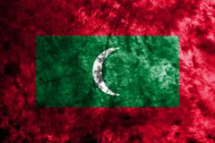 Maldives grunge flag on old dirty wall.  Royalty Free Stock Photography