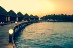 maldives huizen op stapels op water, Stock Afbeelding