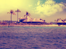 Maldives.Huts near the sea and a palm tree,with a retro effect Royalty Free Stock Photography
