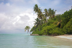 Maldives Island. Medhufushi Island Resort is naturally quiet, serene, authentic Maldivian island royalty free stock image