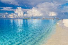 Maldives island beach background. Vacation and holiday with palm trees and tropical island beach Stock Photography