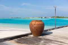 Maldives island beach with vase on wood flooring Royalty Free Stock Image