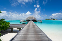 Maldives island resort. Footbridge leading to the jetty on maldives island resort stock photo