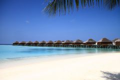 Maldives Island Resort Beach and Overwater Bungalows on Pacific. Ocean royalty free stock photo