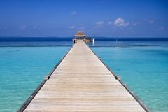 Maldives Island Resort Wood Pier and Turquoise Pacific Ocean Water. stock image
