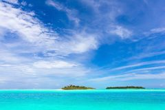 Maldives islands. Scenic view of islands or atolls in turquoise Indian ocean with blue sky and cloudscape background, Maldives Islands Royalty Free Stock Photography