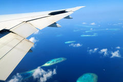 Maldives islands top view and airplane wing Stock Photography