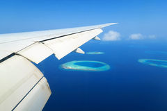 Maldives islands top view and airplane wing Royalty Free Stock Photo