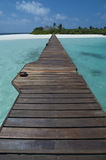 Maldives - Jetty over a tropical lagoon Royalty Free Stock Photography