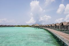 Tropical paradise resort during a sunny day. Maldives, July 29, 2017: Tropical paradise resort on a sunny day royalty free stock photo