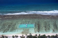 Maldives,Locals and tourists relax on beach, aerial , Royalty Free Stock Photography