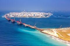 Maldives Male capital city island airport bridge aerial photo. Sea stock photography