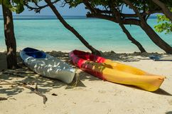 Two colorful boats  on the white sand of the tropical island,  Maldives, holidays destination. Maldives - November, 2017: Amazing beach on Maldives with two Stock Image